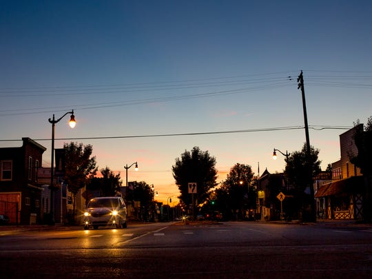 The sun sets over Broadway Street Wednesday, June 29,