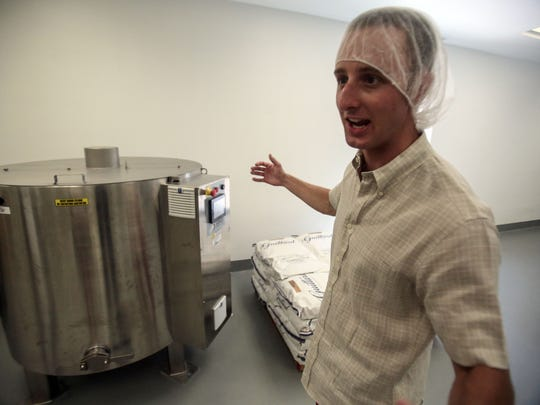 Brandon Weimer, a co-founders of Brandini Toffee shows off a the chocolate melter on Thursday, June 30, 2016.