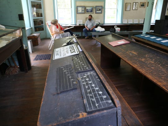 Music lessons on old school desks inside a museum
