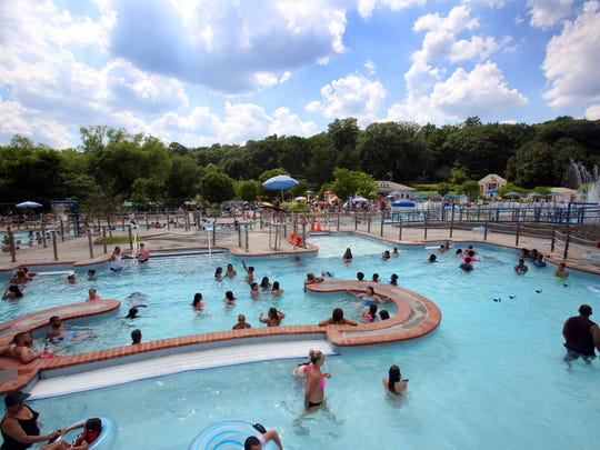 Residents beat the heat by cooling off in the pool at Tibbets park in Yonkers on July 5, 2016.