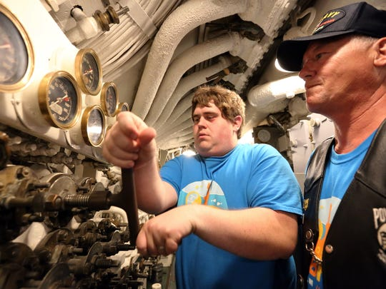 Wisconsin Maritime Museum Overnight Tour Reservations/Group Sales/Rentals Mike Johnson turns on the air manifolds to allow 200 PSI to go through for the whistle blowing ceremony on USS Cobia on Friday, July 8. On the right is museum tour guide and U.S. Navy and Army veteran Richard Altergott, of Two Rivers.