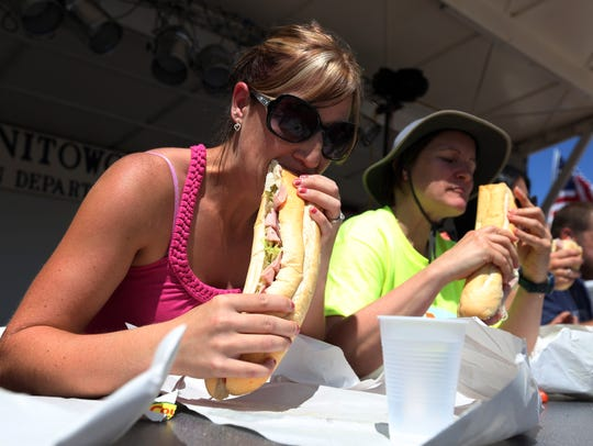 Contestants participate in a sub-eating contest at