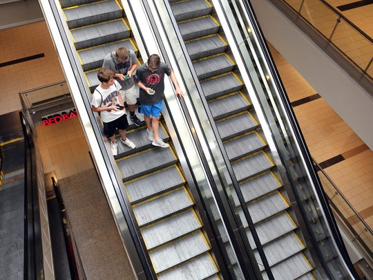 John Conway, 15, Allan Svennson, 14, and Mitchell Collins, 15, all of Pearl River, play Pokemon Go while spending their afternoon at the Palisades Center Mall in West Nyack July, 12, 2016.