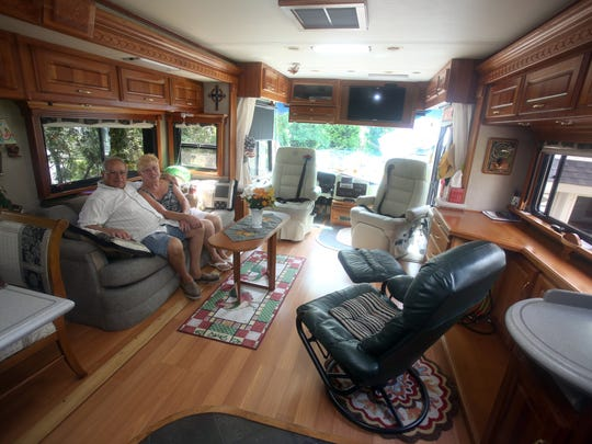 Mauro and Patricia Magliocchino of Hawthorne sit inside their motor home July 14, 2016. The retired couple spend their winters traveling through Florida, and are on the road  throughout other parts of the year. The motor home features a king sized bed, a separate shower and toilet, and kitchen and dining area.