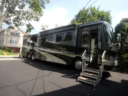 Mauro and Patricia Magliocchino's motor home is parked on the driveway of their home in Hawthorne July 14, 2016. The retired couple spend their winters traveling through Florida, and are on the road  throughout other parts of the year. The motor home features a king sized bed, a separate shower and toilet, and kitchen and dining area.