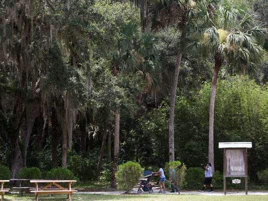 Visitors walk though the Koreshan State Historic Site