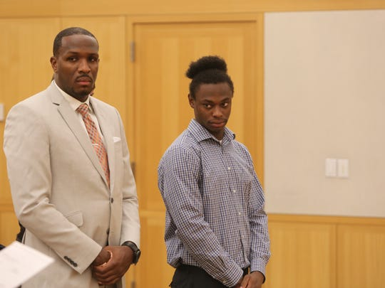 Darren Dawson, right, appears in Westchester County