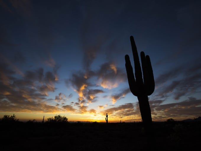 The sun sets over the Superstition Mountains. This