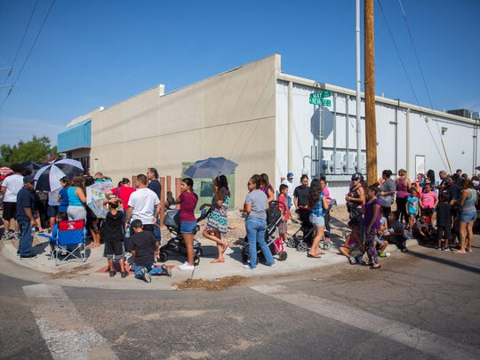 People wait in line outside of Landmark Church to receive