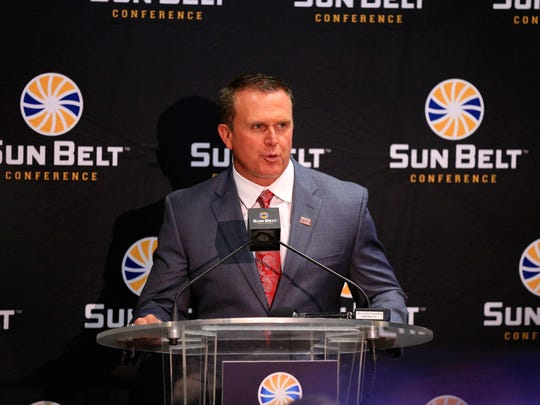 UL football coach Mark Hudspeth addresses reporters