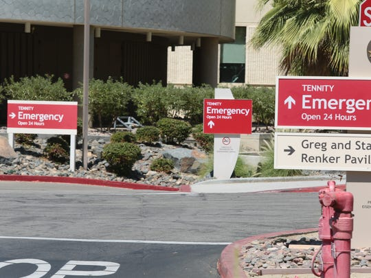 Signs direct patients to the emergency room at Eisenhower