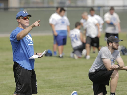 Oshkosh West coach Ken Levine points to where he wants players to line up during the first practice of the season on Tuesday.