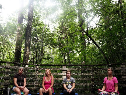 Participants join in a group meditation at Audubon Corkscrew Swamp Sanctuary on Aug. 6, 2016. The monthly guided meditations are led by Bethanny Gonzalez.