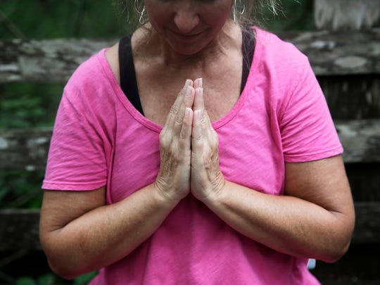 Beth McCann of Fort Myers is led in a group meditation at Corkscrew Swamp Audubon Sanctuary in 2016.
