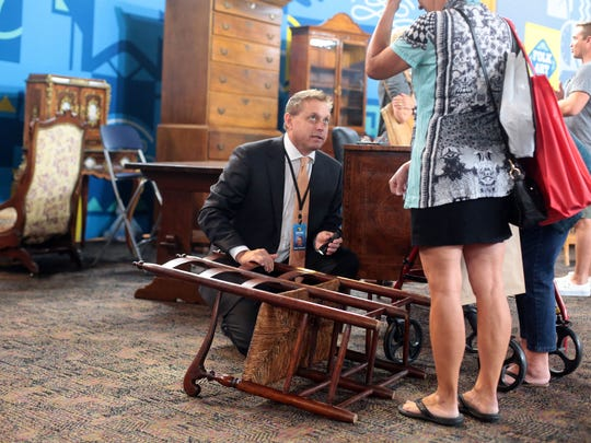 Brian Witherell of Witherell's appraises furniture during  Antiques Roadshow's stop in Palm Springs, CA on Saturday, August 6, 2016.