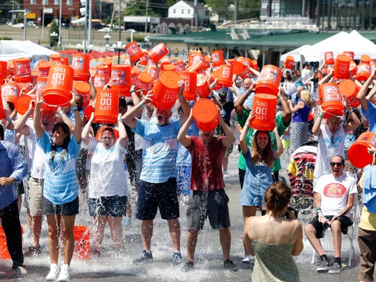 Participants get soaked in the annual Ice Bucket Challenge at Empire City Casino in Yonkers, Aug. 7, 2016. The event raises funds for ALS research and has Yonkers roots.