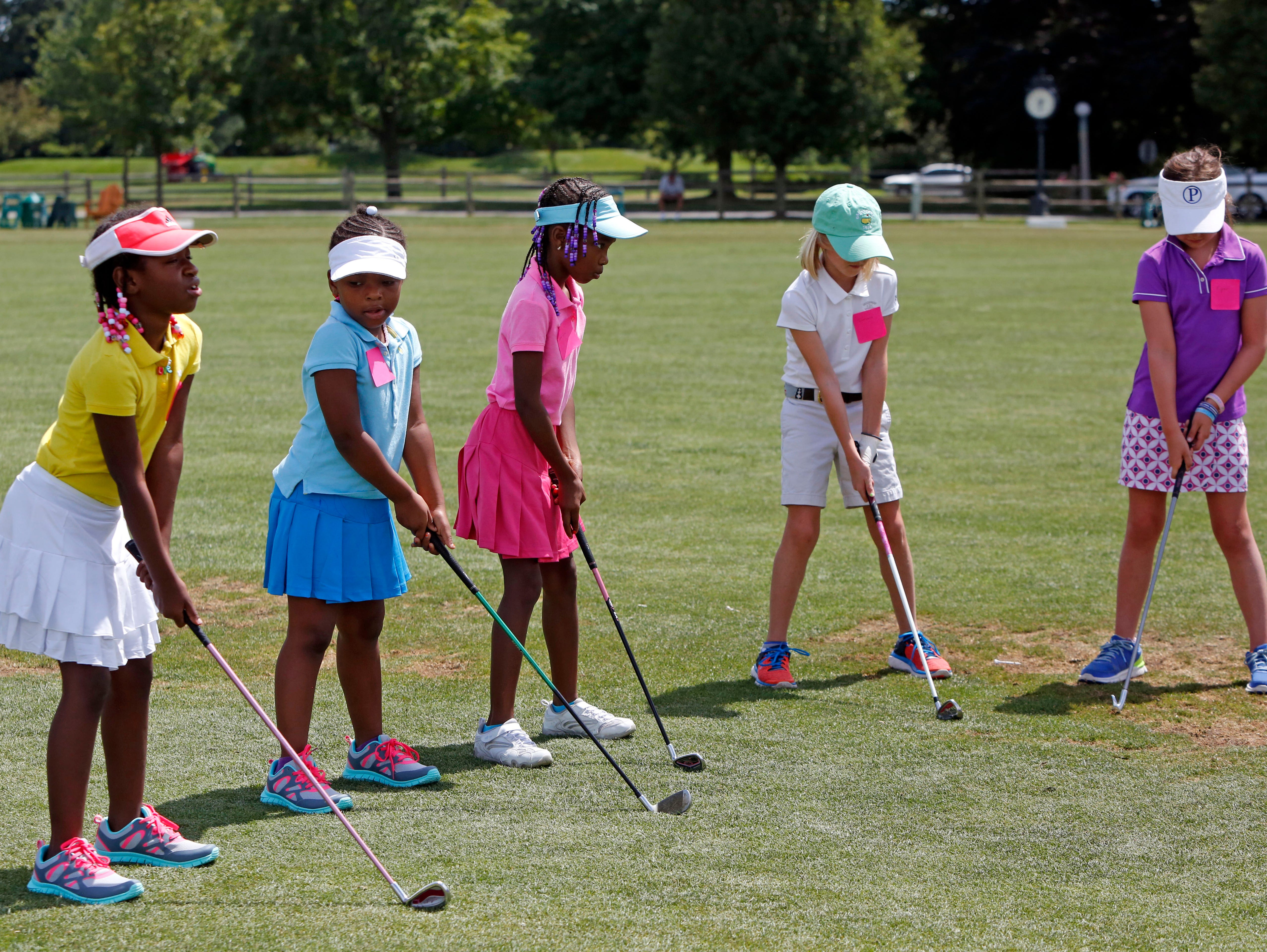Girls practice their stance during the Women's Metropolitan Golf Association's annual Girls to the Tee event at Westchester Country Club in Rye, Aug. 8, 2016. The free clinic, for girls ages 6-18, is an afternoon of instruction and networking to help show girls who are learning the game that they are part of a larger group.