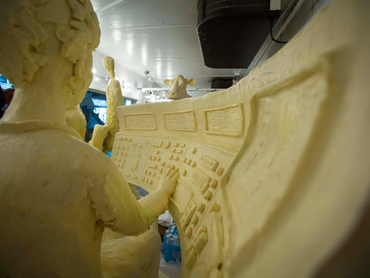 Butter sculptor Sarah Pratt works on her newest creation