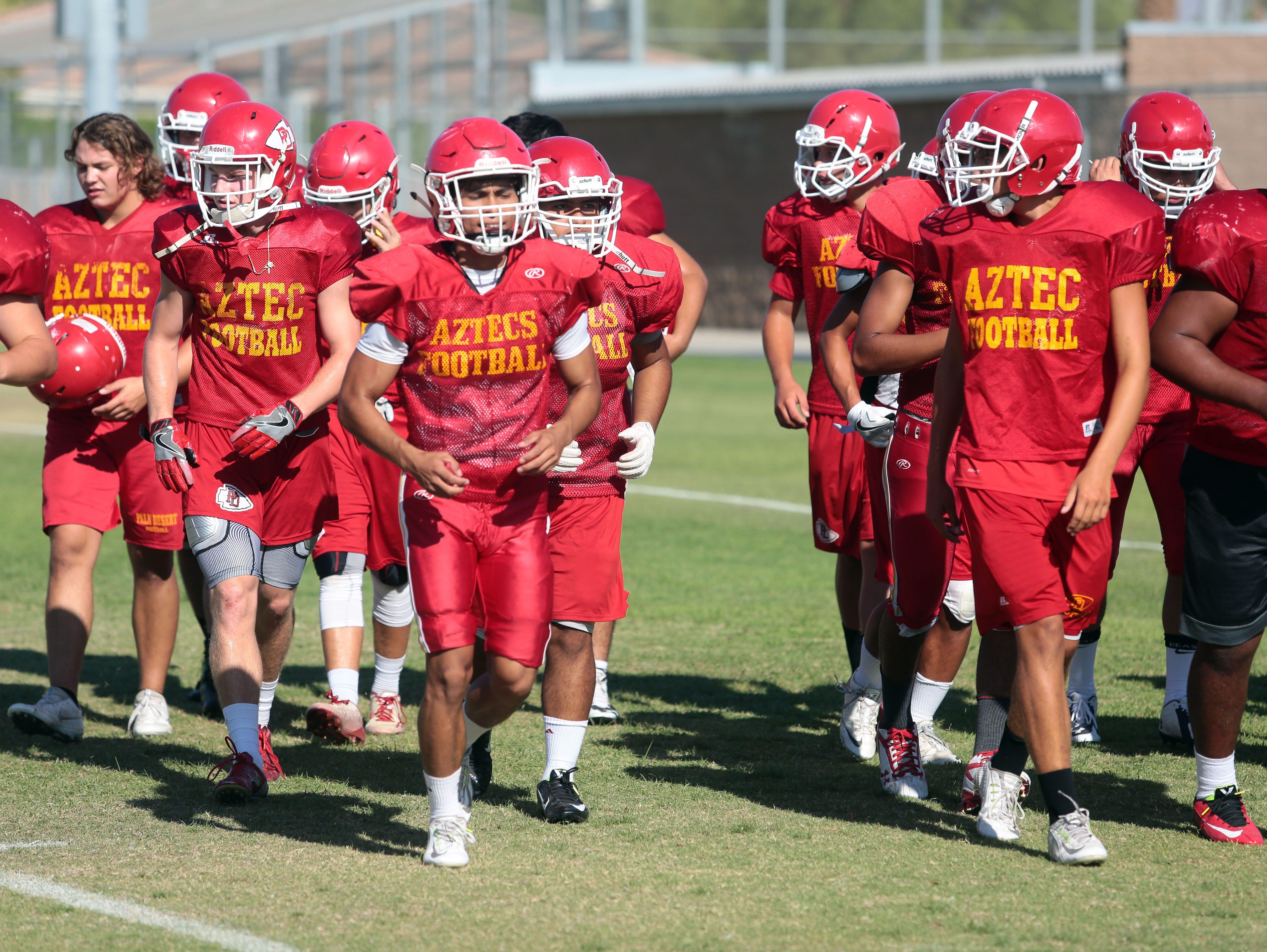 The Palm Desert High School football team practice on Tuesday, August 9, 2016 in Palm Desert.