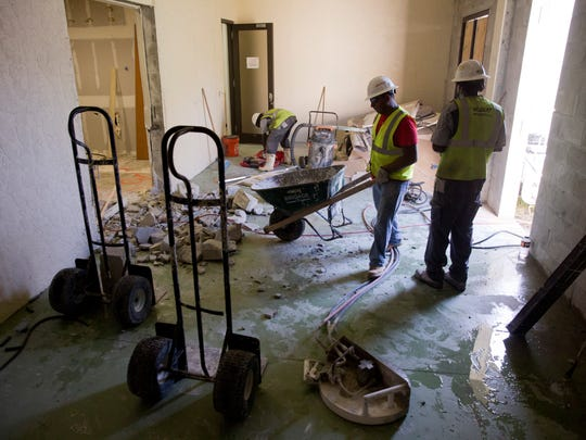 Construction workers with Wildcat Renovation work to update and enlarge the Children's Crisis Center doubling it's capacity from four children to eight Thursday, August 11, 2016 at the David Lawrence Center in Naples.