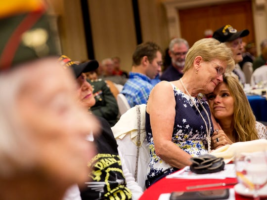 Margaret Foley, left, finds comfort during an emotional moment with her friend Kena Yoke during the seventh annual Greatest Generation & Beyond Breakfast at the Hilton Naples Saturday, August 13, 2016.