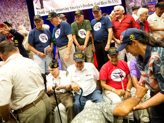 Veterans come together at the conclusion of the seventh annual Greatest Generation & Beyond Breakfast for a group photo at the Hilton Naples Saturday, August 13, 2016.
