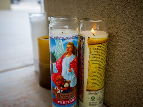Devotional candles were left on Saturday, Aug. 13, 2016, at the entrance to the Hatch Valley Regional Public Safety building by people to honor slain Hatch Police Officer Jose Chavez,.