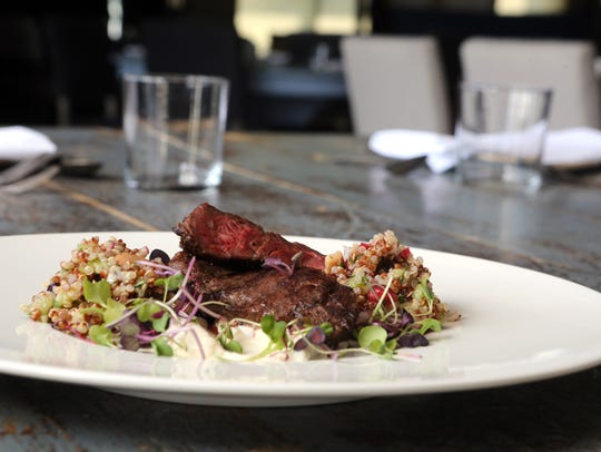 Skirt steak, with quinoa, pomegranate seeds, mixed