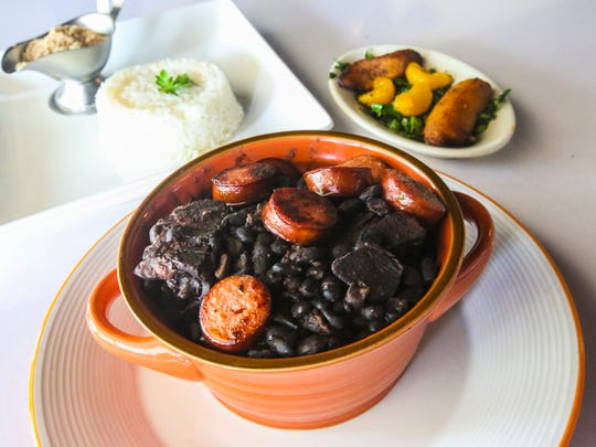 Cafe Brazil, where you can find many of the traditional foods of Olympic host city Rio. Owner Carlos Lopes cooked up an order of feijoada (black-bean-pork stew) with rice and plantains.