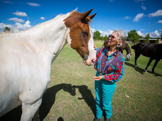 "Pat Buls checks in on Rio at the Rockin' Horse Riding Academy. The singing cowgirl poet said she often sings to horses on her Shining Heart Farm in Radium Springs, where she has boarding stables and training classes. ""They're my best audience,"" Buls said."