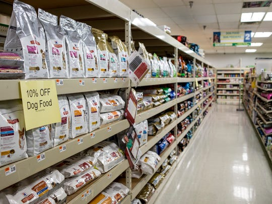 Sale signs are displayed on food items Tuesday, August 16, 2016 at Pet Supplies Plus in Fort Gratiot. The store will be closing in September.