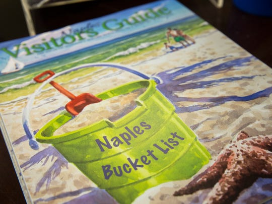 A Naples Visitors guide sits on the Welcome Desk at The Greater Naples Area Chamber of Commerce.