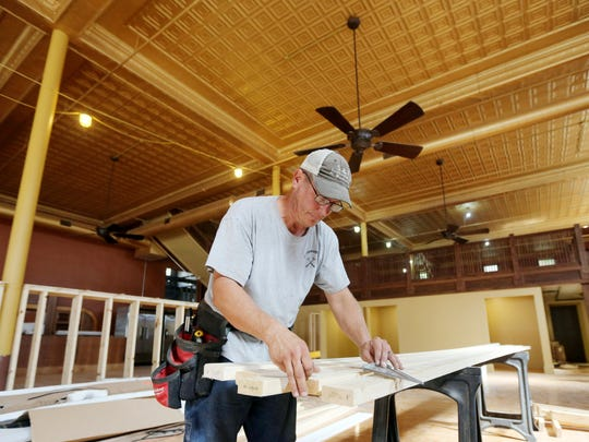 Don Sadler, co-owner of S&F Construction of Fort Madison, works on building an interior wall for Burlington Bent River, a brewery and restaurant being opened in the former JC Penney building in Burlington. The business is expected to be open in October.