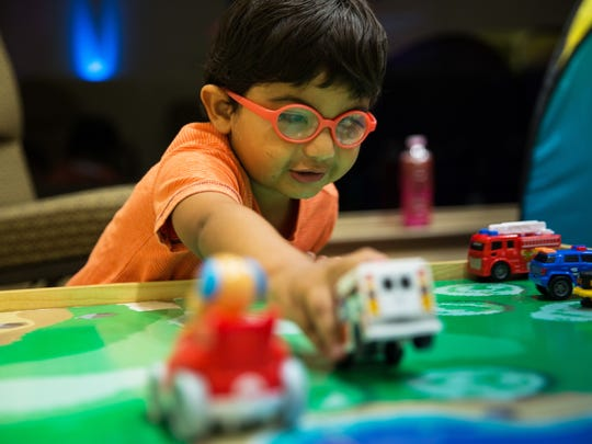 Jeremiah Reyes, 3, plays with toy cars in the sensory