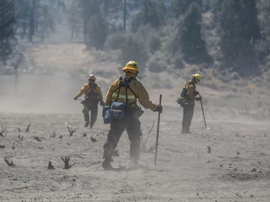 Firefighters search for hot spots in an area burned by the Blue Cut Fire on the eastern edge of Wrightwood on Thursday, August 18, 2016