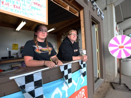 Manitowoc Speedway organization president Todd Humphrey brings many friends and family to work at the speedway. Here, Humphrey's niece, Kylee Humphrey, and his cousin-in-law, Jacqui Sander, are tending the kids' club stand on Friday, July 15.