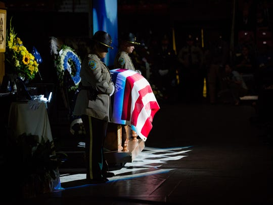 Sheriff's deputies stand by the casket of slain Hatch, NM police officer José Chavez during his memorial at the Pan American Center in Las Cruces, NM, Sunday, August 21, 2016.