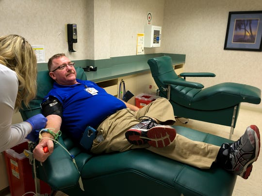 Larry Lasky, of Naples, gives a blood donation at the NCH Community Blood Center on Tuesday, Aug. 23, 2016, in Naples.  NCH Community Blood Center is one of several Southwest Florida blood centers to add a FDA-approved Zika virus test to its blood screening process.