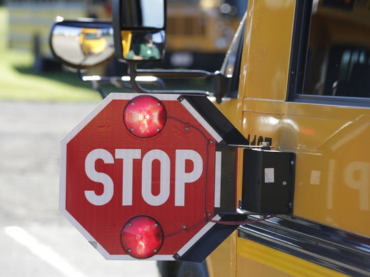 Failure to stop when a bus has its signs deployed can yield hefty consequences.