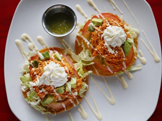 The tostadas de tinga pollo from Candela at 2925 Ingersoll Wednesday, Aug. 24, 2016.