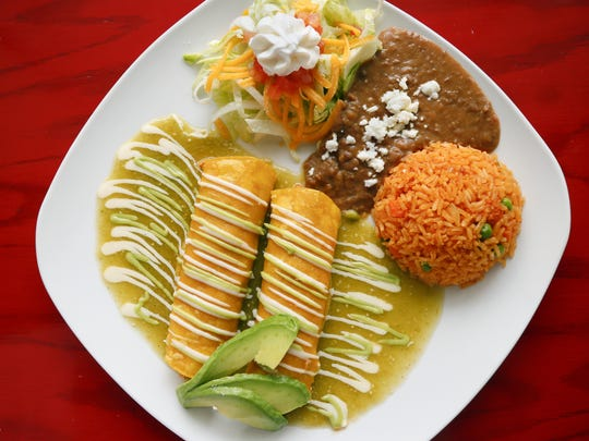 The enchiladas verde from Candela, located at 2925 Ingersoll Ave. Wednesday, Aug. 24, 2016.