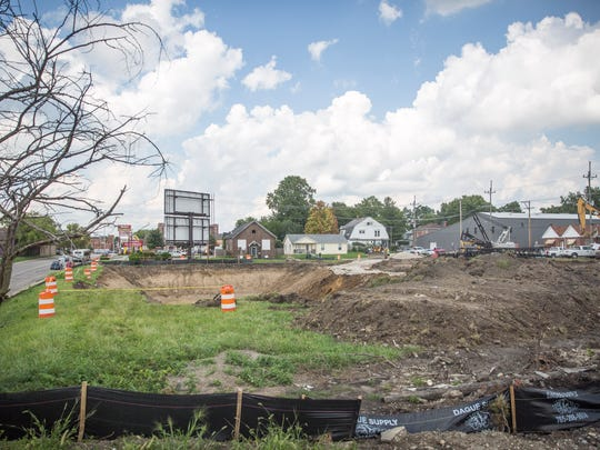 Crews working for the Muncie Sanitary district begin digging Monday afternoon next to the Madison Street underpass to help prevent flooding which frequently closes the bridge.