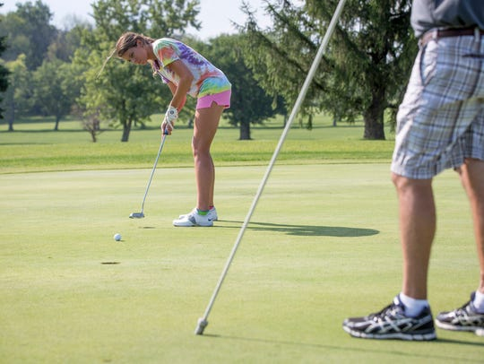 A Delta High Scchool golfer practices with her team at Lakeview Golf Course in Eaton in this file photo from 2016.