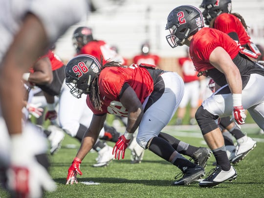 Anthony Winbush, one of Ball State's defensive linemen, runs drills with the team during spring practice on April 5 at Scheumann Stadium.