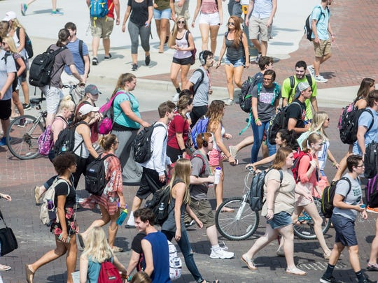 """A mob of students cross N. McKinley Ave. and W. Riverside Ave. at the """"Scramble Light"""" on Tuesday at Ball State University. This year's freshman class of 3,911 students is the third-largest of all time."""