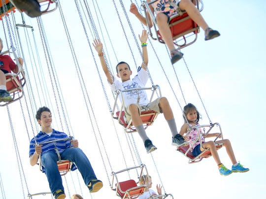 Kids swing from high above the Mountain State Fair in 2013.