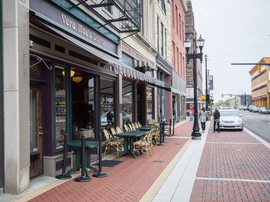 Outdoor seating is ready for customers on the sidewalk