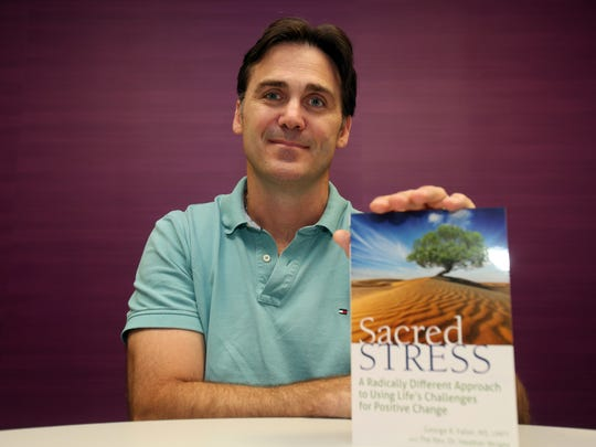 Retired FDNY firefighter and therapist George Faller with his book Sacred Stress Sept. 1, 2016. Faller, of Somers, helped many fellow firefighters with the lingering effects of the attacks on the World Trade Center.