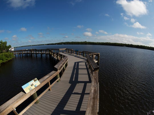 A boardwalk juts out into Estero Bay Aquatic Preserve at the Mound House on Fort Myers Beach.
