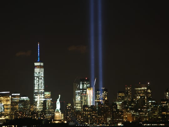 The annual Tribute in Light shines into the night sky